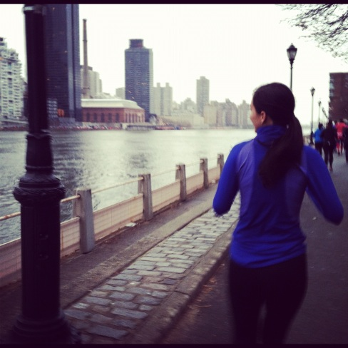 Jenna running along the East River
